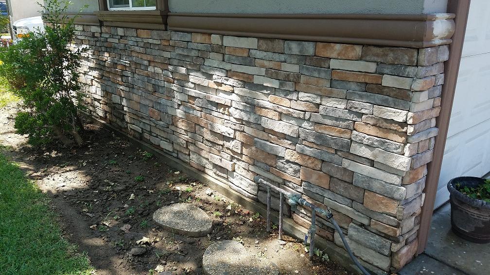 Искусственный камень в отделке фасада